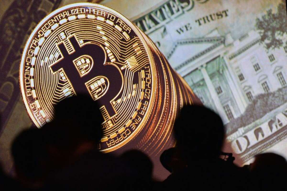 Bitcoin coins are pictured in a file photo. The cryptocurrency generally remains electronic.