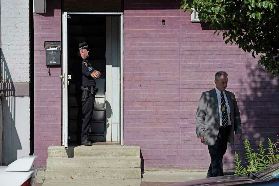 Members of the Troy Police Department stand outside a home on 3rd Street where two people were found dead inside on Wednesday, Aug. 30, 2017, in Troy, N.Y.  (Paul Buckowski / Times Union) Photo: Albany Times Union