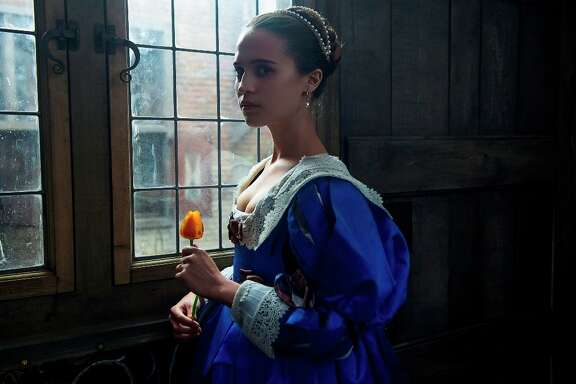 """This image released by The Weinstein Company shows Alicia Vikander in """"Tulip Fever."""" (Alex Bailey/The Weinstein Company via AP)"""