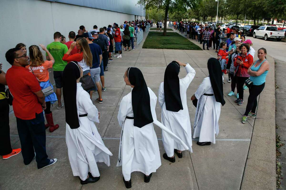Dominican Sisters of Mary Immaculate Province join a line of people waiting to volunteer at NRG Center, which opened its doors to a capacity of 10,000 evacuees in the wake of Tropical Storm Harvey Wednesday, Aug. 30, 2017 in Houston.