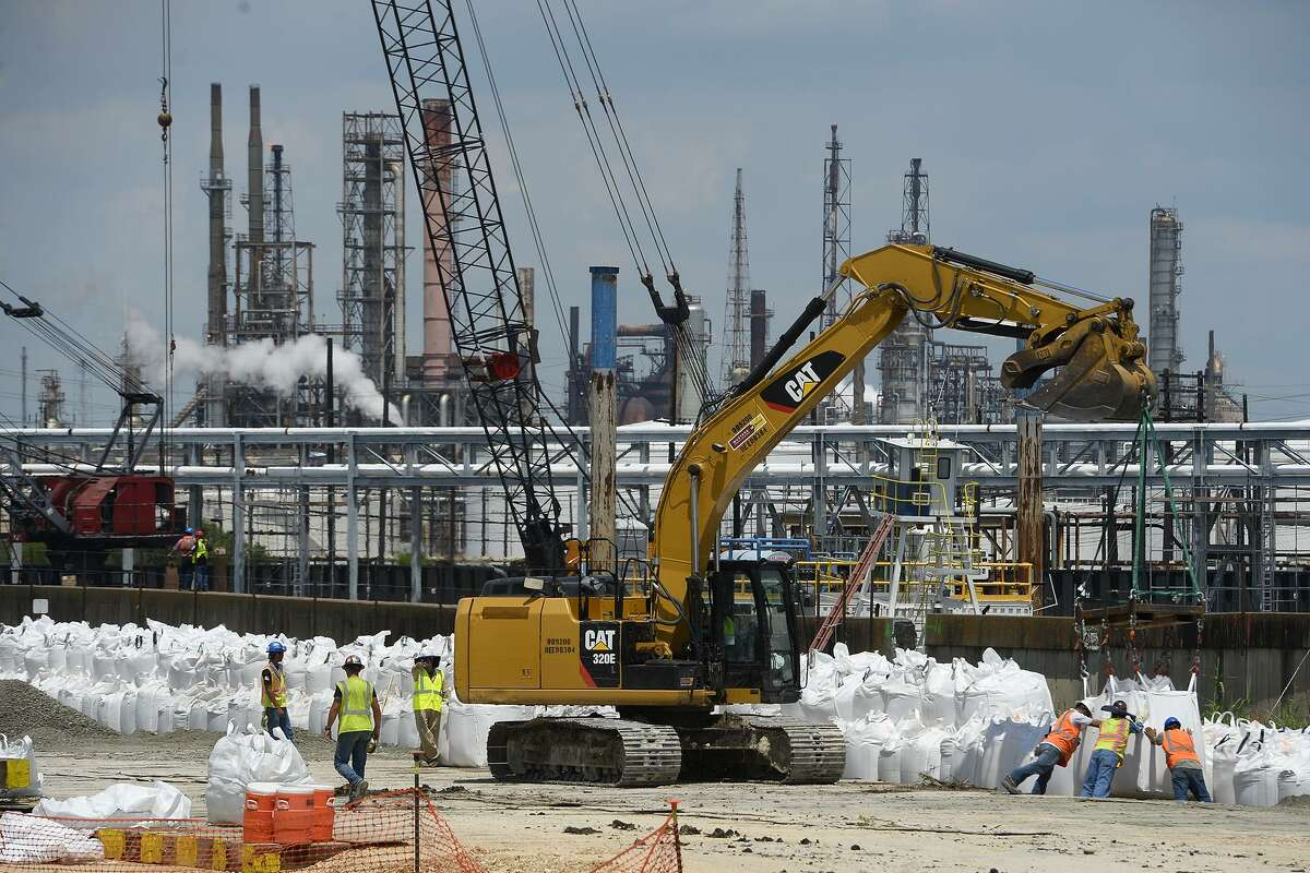 Prior to Hurricane Harvey workers fortified a damaged levee at Valero Energy Corp.'s Port Arthur refinery, which reported a fire on Tuesday.