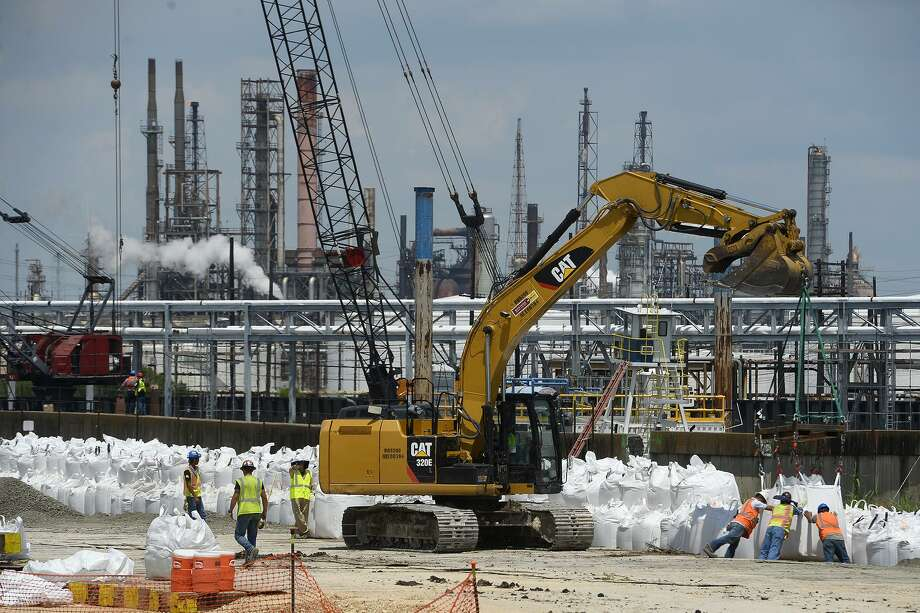 Prior to Hurricane Harvey workers fortified a damaged levee at Valero Energy Corp.'s Port Arthur refinery, which reported a fire on Tuesday. Photo: Ryan Pelham /Ryan Pelham /The Enterprise / ©2017 The Beaumont Enterprise/Ryan Pelham