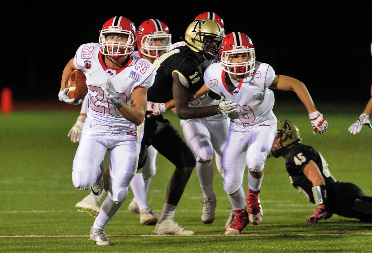 New Canaan's Quintin O'Connell breaks free to carry the ball to the endzone for a touchdown during high school football action against Trumbull in Trumbull, Conn. on Friday Nov. 4, 2016. O'Connell is New Canaan's leading returning receiver as a junior.