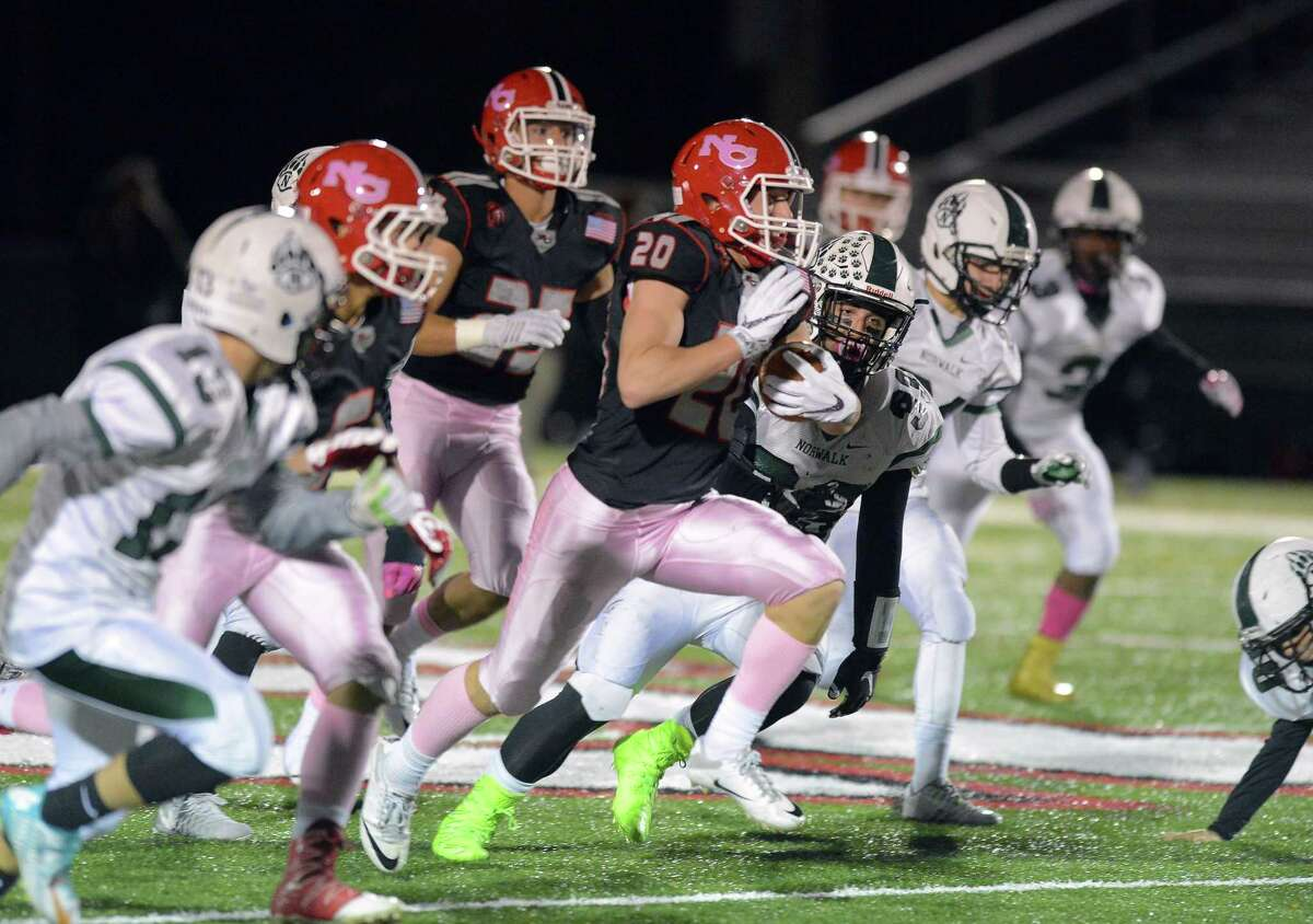 New Canaan Quintin O'Connell carry the ball past Norwalk in a FCIAC varsity football game at New Canaan High School on Friday, Oct. 28, 2016.