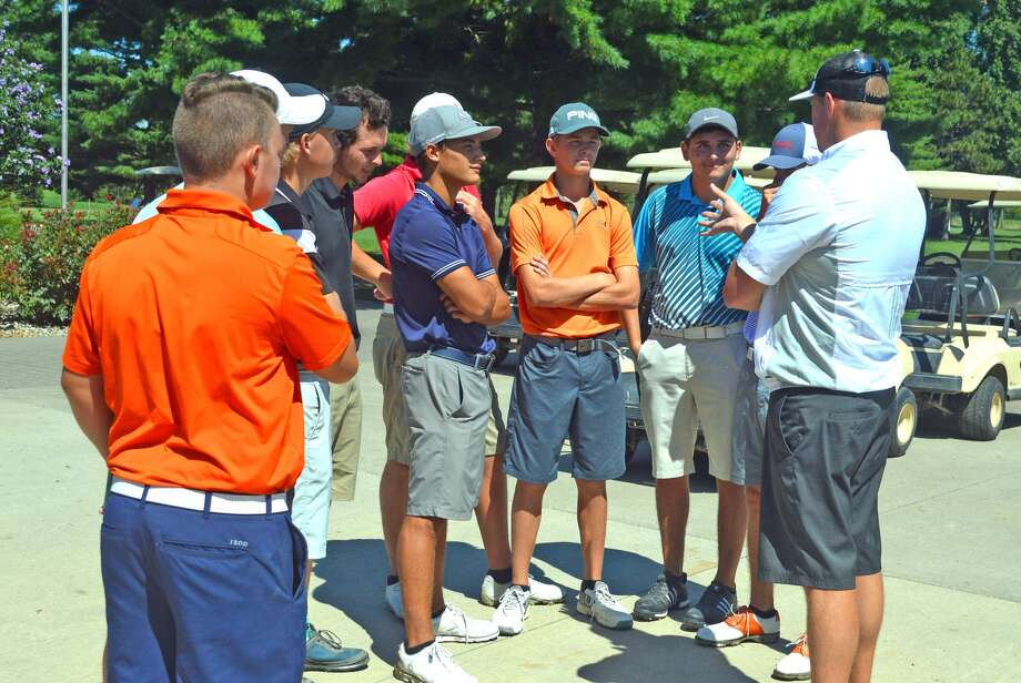 Edwardsville boys' golf coach Adam Tyler talks to his team after practice earlier this season. EHS will play Friday and Saturday in the Antigua National tournament in Chandler, Ariz.