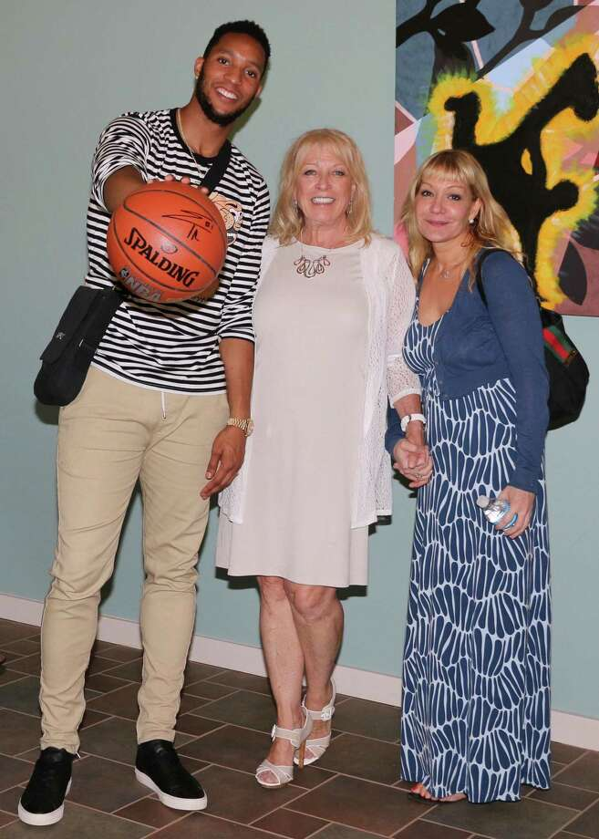 Evan Turner of the Portland Trailblazers, with a newly autographed basketball, is photographed with The Glenholme School Executive Director Maryann Campbell and Diana Nichols, the Glenholme parent who coordinated the July 20 visit to the Washington campus. Photo: Courtesy Of Glenholme School / The News-Times Contributed