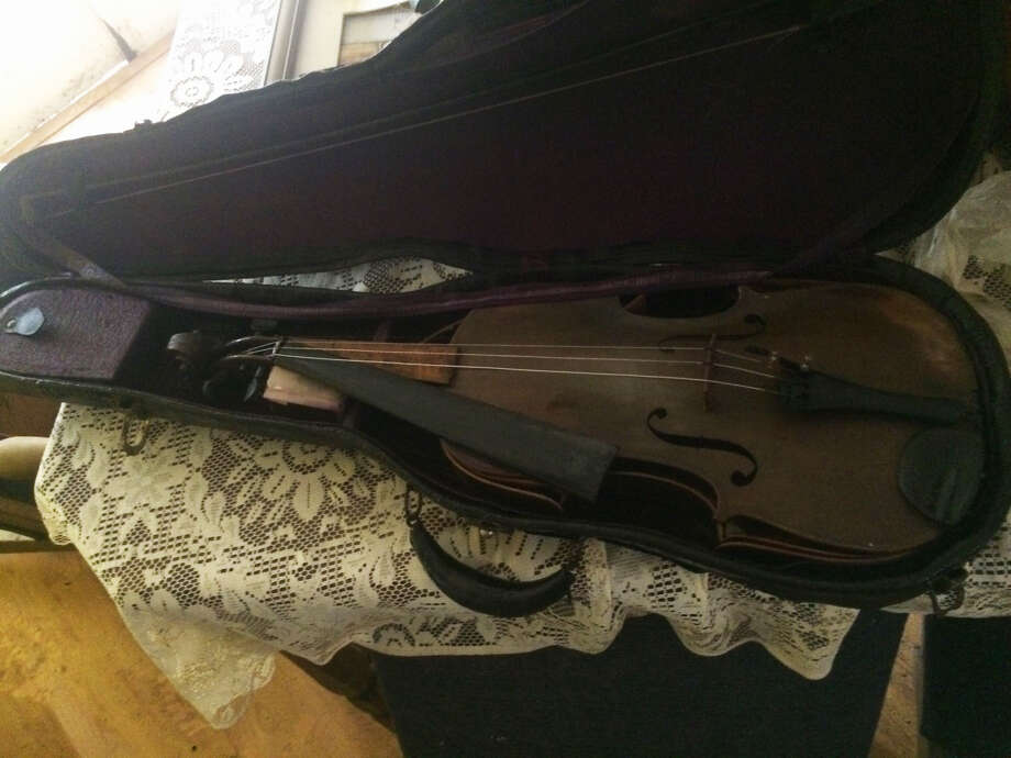 The one heirloom Chris Svahn had hoped would survive Harvey, recovered from his flooded home in Dickinson on Wednesday, Aug. 30, 2017, was his late father's violin. Photo: Chris Svahn, Courtesy Photo