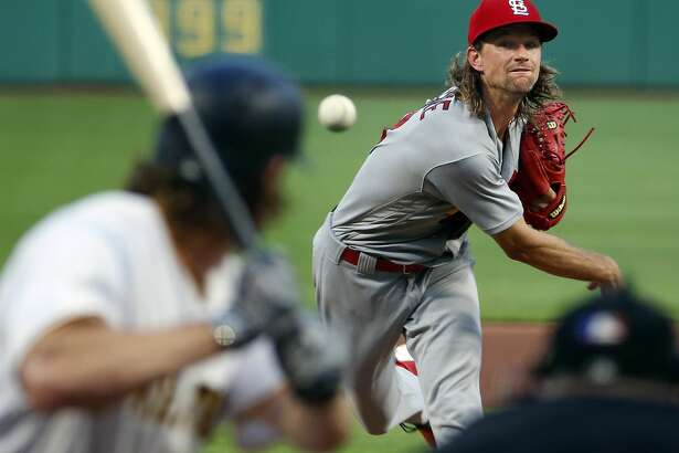 St. Louis Cardinals starter Mike Leake watches a pitch during the fourth inning of the team's baseball game against the Pittsburgh Pirates in Pittsburgh, Friday, July 14, 2017. (AP Photo/Gene J. Puskar)