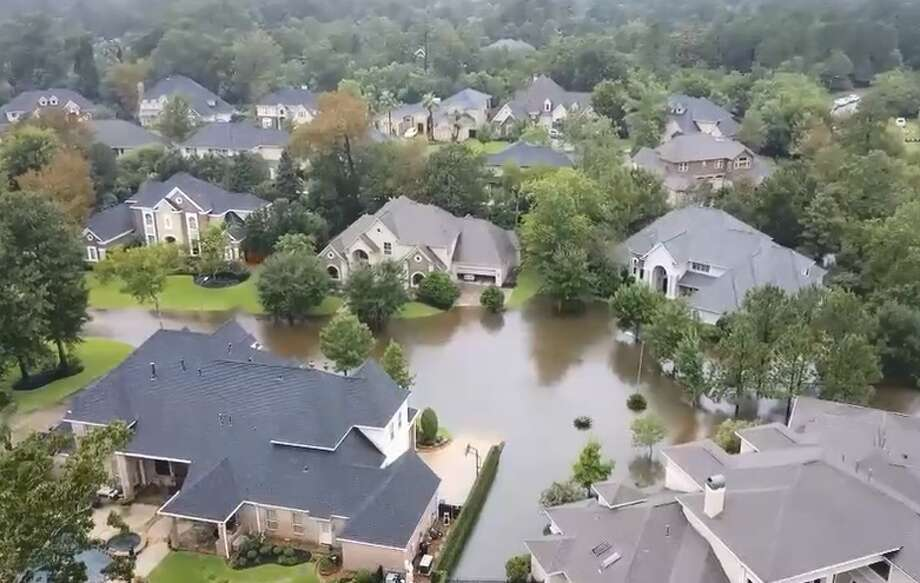 Screenshots from a video posted Tuesday by Southern Drone Solutions shows flooding along Royal Shores Drive and the surrounding neighborhood in Kingwood. Rescue operations were ongoing Wednesday morning. Photo: Southern Drone Solutions