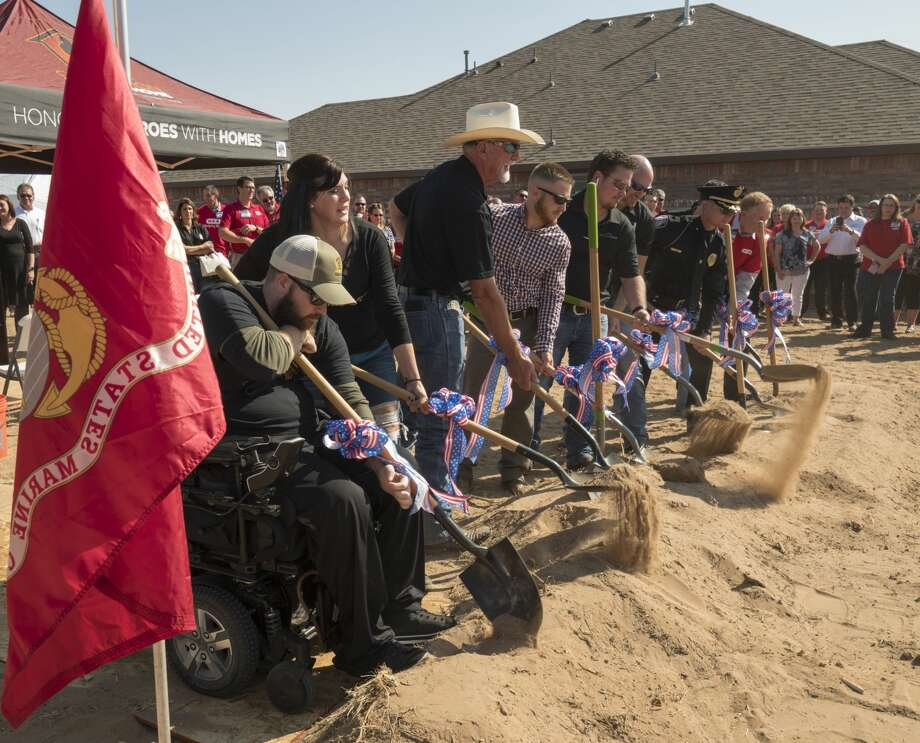 Jake Churchwell, his wife Shannon and other donors dig a ceremonial shovel of dirt 8/30/17  morning on Day Break Way where the Churchwell family will get new home built and given to them mortgage free. Tim Fischer/Reporter-Telegram Photo: Tim Fischer/Midland Reporter-Telegram