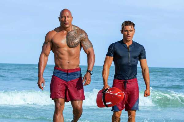"This image released by Paramount Pictures shows Dwayne Johnson as Mitch Buchannon, left, and Zac Efron as Matt Brody in ""Baywatch."" (Frank Masi/Paramount Pictures via AP) ORG XMIT: NYET733"