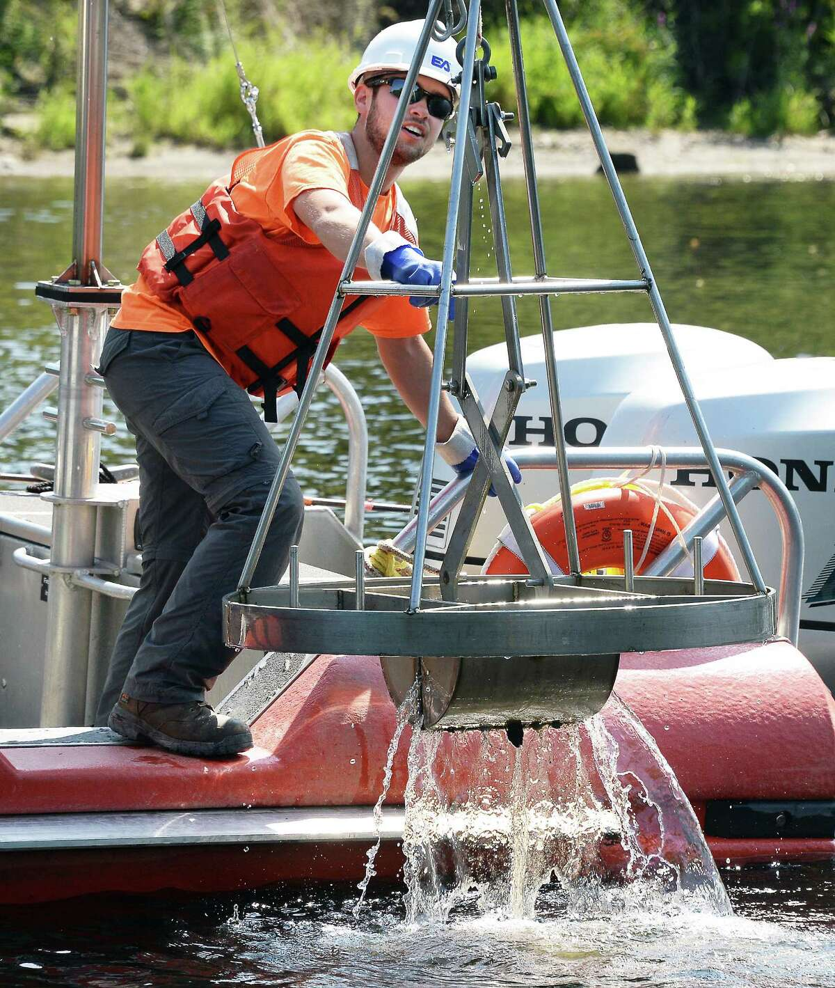 EA Engineering, Science and Technology geologist Justin Marra collects sediment samples from the upper Hudson River Wednesday August 30, 2017 in Moreau, NY. (John Carl D'Annibale / Times Union)
