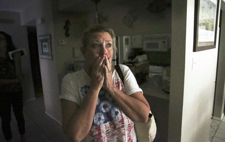 Robyn Harrelson, a teacher in San Antonio, is stunned to see that the interior who owns a second home in Rockport. Fears of a destroyed interior are vanquished as Robyn Harrelson is stunned to see the interior of her condo as recovery proceeds in Rockport on August 30, 2017. Fears of a destroyed interior are vanquished as Robyn Harrelson is stunned to see the interior of her condo as recovery proceeds in Rockport on August 30, 2017. Photo: Tom Reel /San Antonio Express-News / 2017 SAN ANTONIO EXPRESS-NEWS