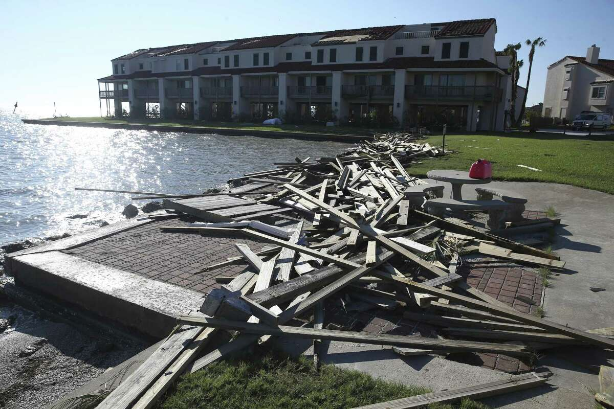 Dock material is strewn up on the shoreline outside the condo of Mark and Robyn Harrelson as recovery proceeds in Rockport on August 30, 2017.