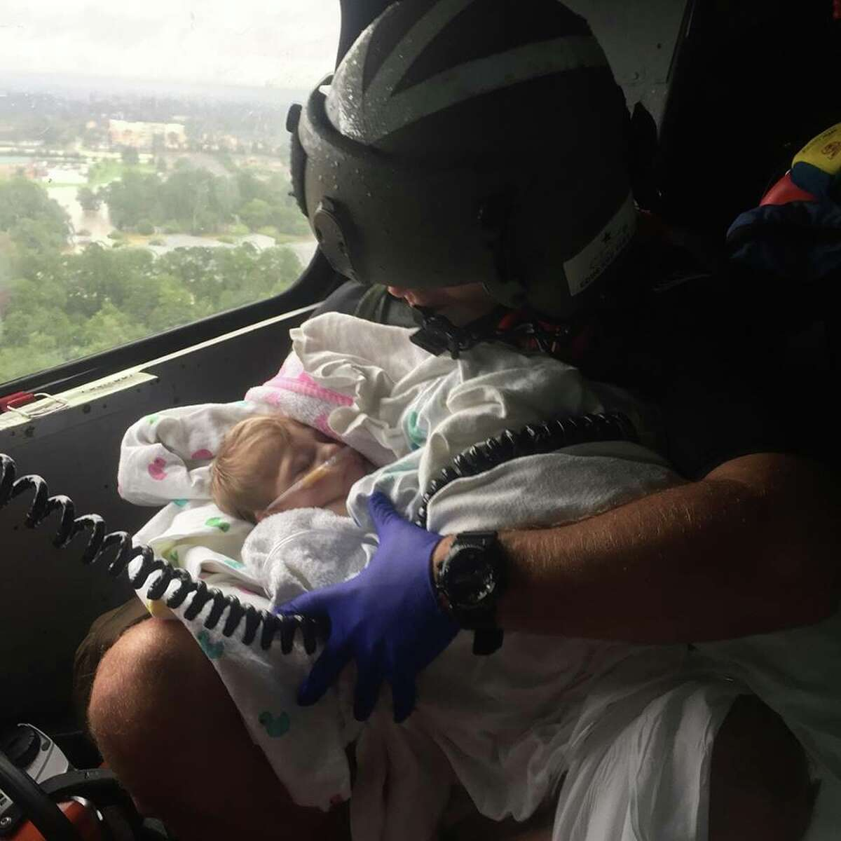 A U.S. Coast Guard aircrew assist infant during the aftermath of Hurricane Harvey in the greater Houston Metro Area. Swipe through to see other photos of Texans being saved during Harvey.