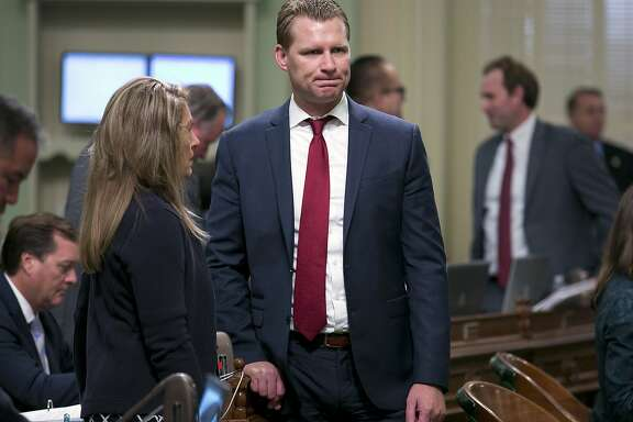 Assembly Republican Leader Chad Mayes, of Yucca Valley, right, talks with fellow GOP Assembly member Marie Waldron, of Escondido, at the Capitol Monday, Aug. 21, 2017, in Sacramento, Calif. Some California Republicans are looking to oust Mayes over his support for extending California's cap and trade legislation last month. (AP Photo/Rich Pedroncelli)