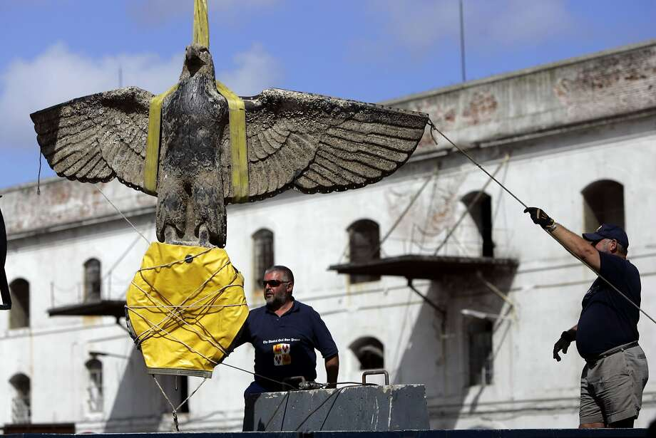 Workers salvaged the eagle from the battleship Admiral Graf Spee in 2006 in Montevideo. Photo: MARCELO HERNANDEZ, Associated Press