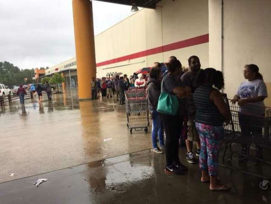 Line outside H-E-B Plus in Beaumont on Wednesday.Photo: Mark Adkins Photo: BE