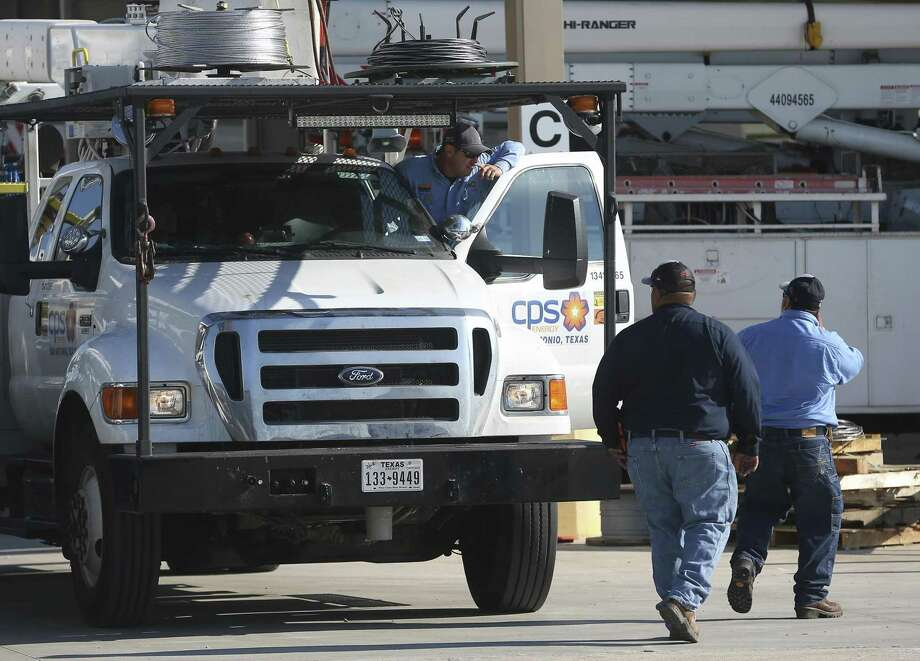 Volunteer CPS Energy employees walk to their vehicles Wednesday as they prepare to travel to Hurricane Harvey-affected areas to help rebuild the power grid. Photo: William Luther /San Antonio Express-News / © 2017 San Antonio Express-News