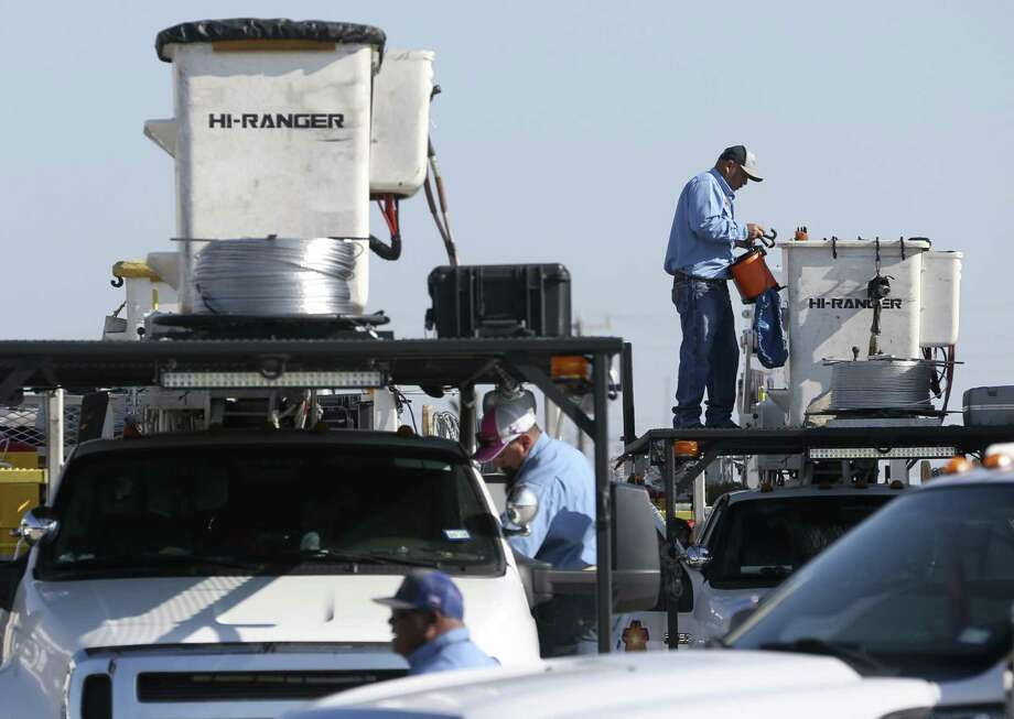 Volunteer CPS Energy employees make final preparations to their vehicles Wednesday as they prepare to travel to Hurricane Harvey-affected areas to help rebuild the power grid. Photo: William Luther /San Antonio Express-News / © 2017 San Antonio Express-News
