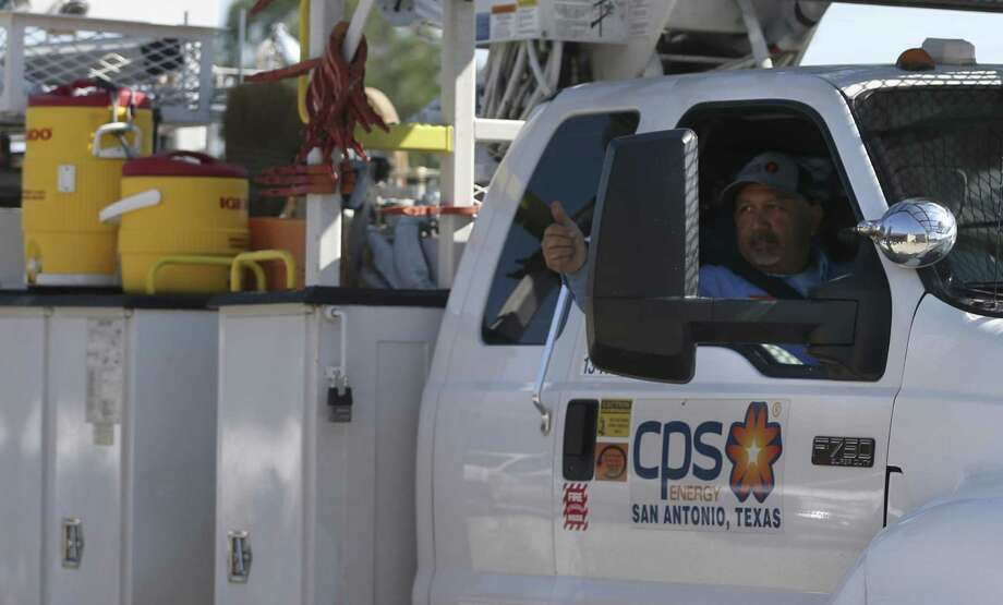 A CPS energy employee gives a thumbs up to other colleagues as he leaves Aug. 30 with a convoy of storm recovery equipment and personnel going to help rebuild the storm-damaged power grid. Photo: William Luther /San Antonio Express-News / © 2017 San Antonio Express-News