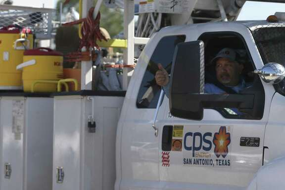 A CPS energy employee gives a thumbs up to other colleagues as he leaves Aug. 30 with a convoy of storm recovery equipment and personnel going to help rebuild the storm-damaged power grid.
