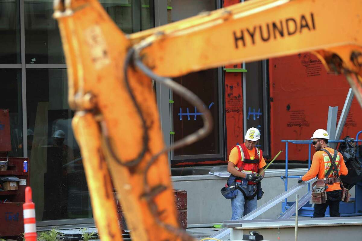 Construction crews work on building a new Marriott Residence Inn on Terry Avenue in downtown Seattle, Tuesday, Aug. 29, 2017.