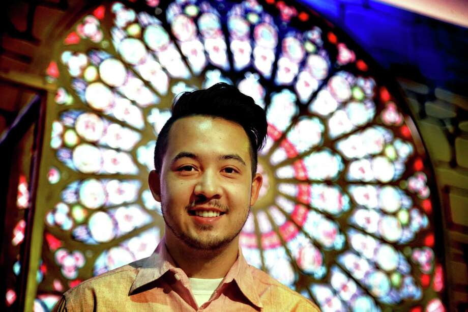 """Designer Nicolas Ponting poses in front of the centerpiece for his set for """"The Hunchback of Notre Dame,"""" which opens Sept. 15 at The Playhouse San Antonio. Photo: Courtesy Ron Cortes"""
