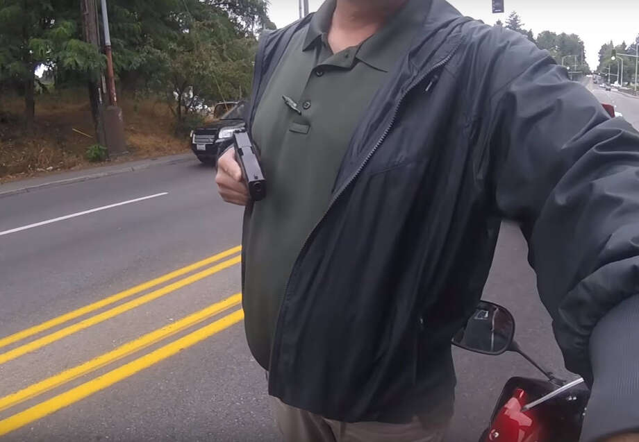 A detective with the King County Sheriff's Office was placed on administrative leave Tuesday morning after a video surfaced showing him pulling a gun on a motorcyclist during a seemingly surprise traffic stop. Photo: Squid Tips Via YouTube