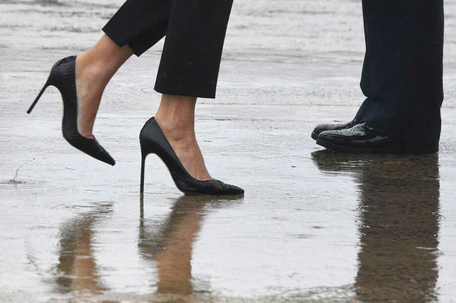 TOPSHOT - First Lady Melania Trump walks on high heels to board Air Force One at Andrews Air Force Base, Maryland, on August 29, 2017 en route to Texas to view the damage caused by Hurricane Harvey. / AFP PHOTO / JIM WATSONJIM WATSON/AFP/Getty Images Photo: JIM WATSON, AFP/Getty Images / AFP or licensors