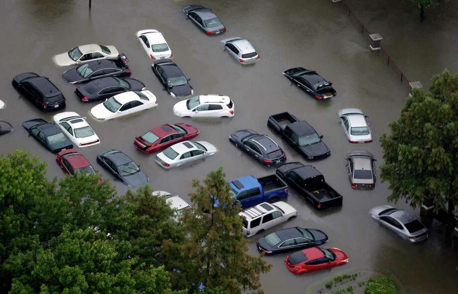 Flooded cars near the Addicks Reservoir are shown as floodwaters rise Tuesday, Aug. 29, 2017, in Houston. Photo: David J. Phillip, Associated Press / Copyright 2017 The Associated Press. All rights reserved.