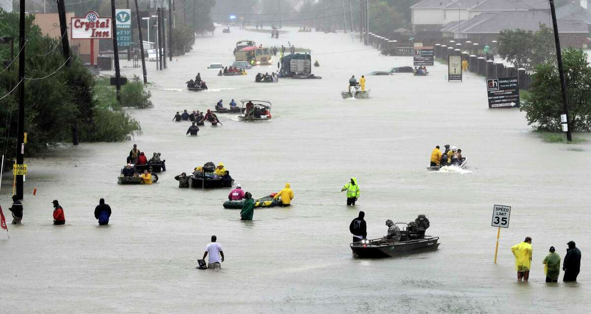Rescue boats fill a flooded street as flood victims are evacuated as floodwaters from Tropical Storm Harvey rise Monday, Aug. 28, 2017, in Houston. (AP Photo/David J. Phillip) ORG XMIT: TXDP401