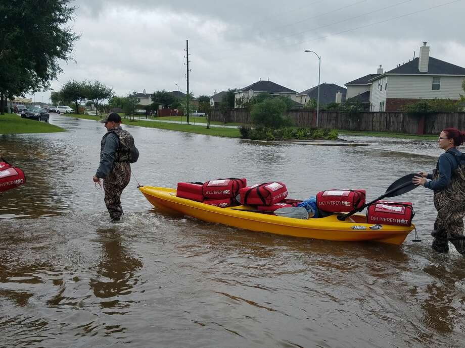 Workers at the Pizza Hut in Sugar Land delivered pizzas to the Village of Oak Lake neighborhood on Aug. 29, 2017. See more photos from Hurricane Harvey ahead.  Photo: Shayda Habib