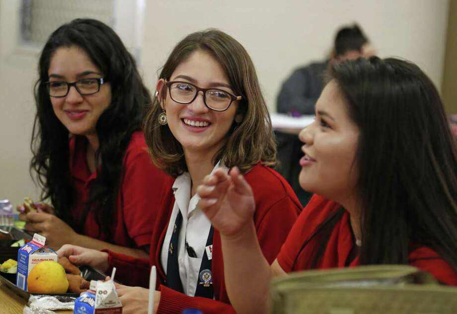 Ruby Polanco,center ,a senior at the Young Women's Leadership Academy, who successfully petitioned SAISD to change its nondiscrimination policy to protect students and employees based on sexual and gender identity and gender expression shares a light moment during her lunch period with fellow students Gabriela Rodriguez,L and Gabriella Salinas on Tuesday, August 29,2017 Photo: Ron Cortes, Freelance / For The San Antonio Express-News