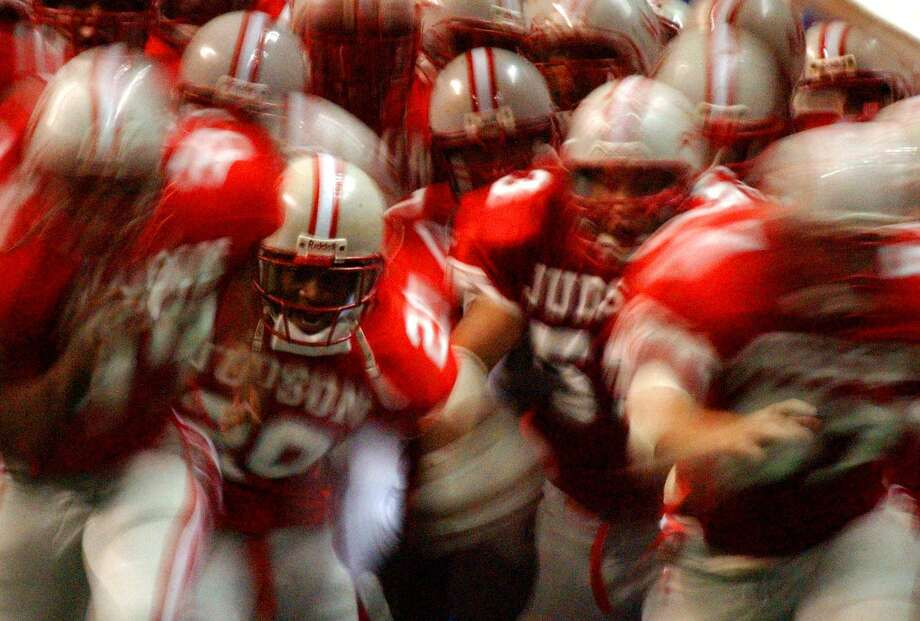 The Judson Rockets make their way onto the field on Nov. 24 , 2001, at the Alamodome before their game against the Taft Raiders. Photo: William Luther /San Antonio Express-News / SAN ANTONIO EXPRESS-NEWS