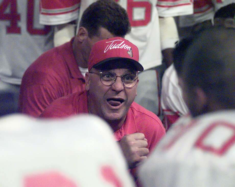 Judson coach D.W. Rutledge rallies his team during a timeout in the fourth quarter of the state semifinal game against Aldine Eisenhower on Dec. 5, 1998 in the Astrodome in Houston. Photo: Express-News File Photo / SAN ANTONIO EXPRESS-NEWS