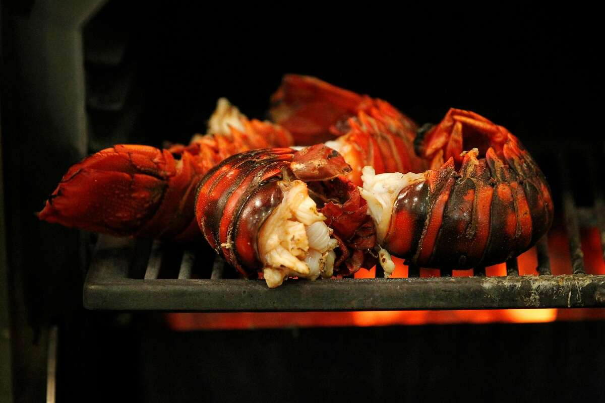 Lobster tails cook over open flame in The Restaurant at Meadowood Napa Valley during their annual Twelve Days of Christmas guest chef event Dec. 9, 2014 in St. Helena, Calif.