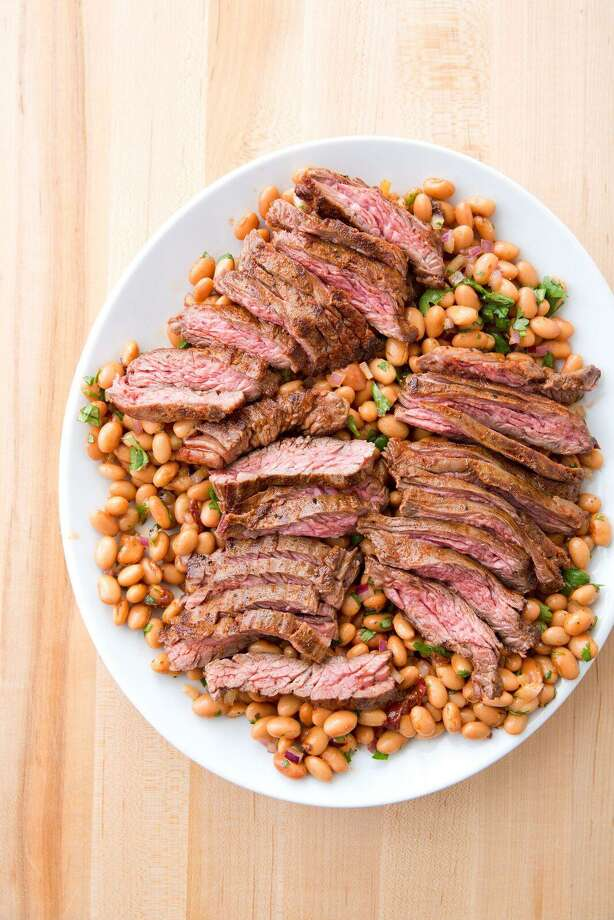 """Skirt Steak with Pinto Bean Salad from """"The Complete Make-Ahead Cookbook"""" by America's Test Kitchen. Photo: Courtesy America's Test Kitchen"""