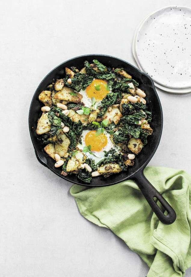 "Lazy Potato Hash with Kale, Pesto and Eggs from ""The Savvy Cook"" by Izy Hossack. Photo: Izy Hossack / Octopus Publishing Group"