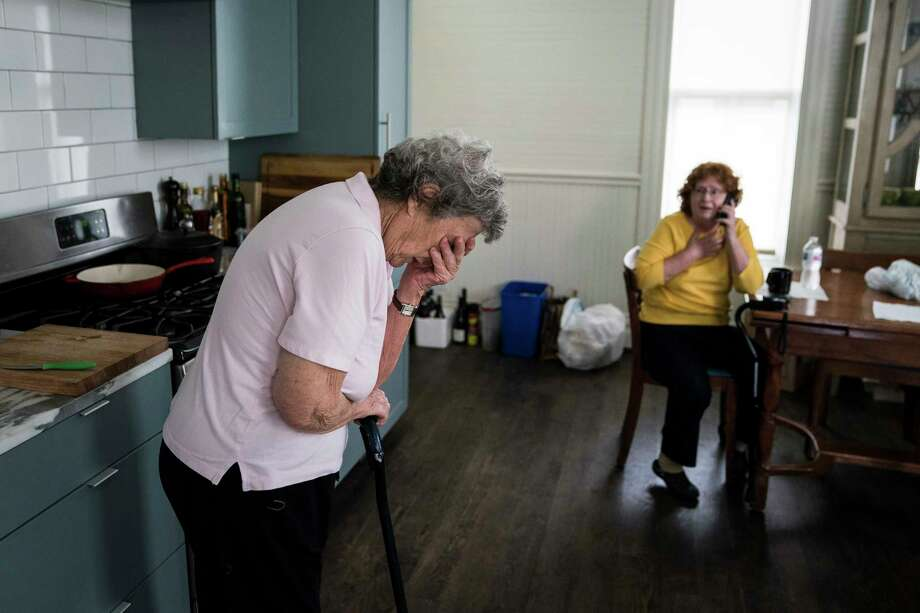 Becky Bain, 58, and her mother Miriam Bain, 82, react as a family member calls to tell them their home survived Hurricane Harvey. They evacuated to a shelter, and are staying in a rental home owned by Anne Whitlock and Michael Skelly in Houston. Photo: Washington Post Photo By Jabin Botsford / The Washington Post