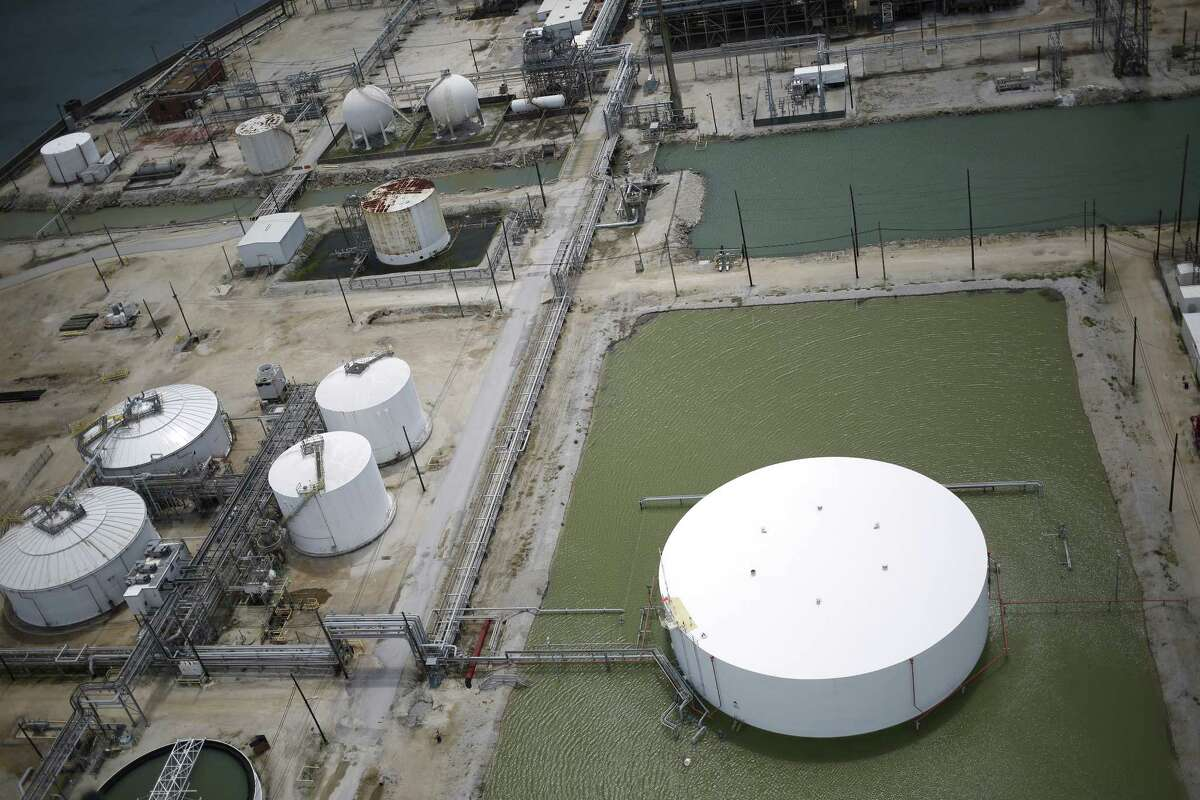 Rainwater from Hurricane Harvey surrounds an oil storage tank near an oil refinery in this aerial photograph taken above Texas City, Texas, U.S., on Wednesday, Aug. 30, 2017. Unprecedented flooding from the Category 4 storm that slammed into the state's coast last week, sendinggasoline pricessurging as oil refineries shut, may also set a record for rainfall in the contiguous U.S., the weather service said Tuesday. Photographer: Luke Sharrett/Bloomberg