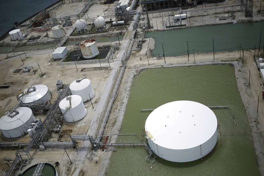 Rainwater from Hurricane Harvey surrounds an oil storage tank near an oil refinery in this aerial photograph taken above Texas City, Texas, U.S., on Wednesday, Aug. 30, 2017. Unprecedented flooding from the Category 4 storm that slammed into the state's coast last week, sendinggasoline pricessurging as oil refineries shut, may also set a record for rainfall in the contiguous U.S., the weather service said Tuesday. Photographer: Luke Sharrett/Bloomberg Photo: Bloomberg / © 2017 Bloomberg Finance LP