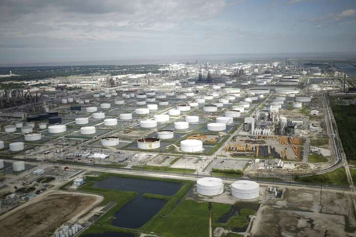 Oil refinery storage tanks stands in this aerial photograph taken above Texas City, Texas, U.S., on Wednesday, Aug. 30, 2017. Unprecedented flooding from the Category 4 storm that slammed into the state's coast last week, sendinggasoline pricessurging as oil refineries shut, may also set a record for rainfall in the contiguous U.S., the weather service said Tuesday. Photographer: Luke Sharrett/Bloomberg