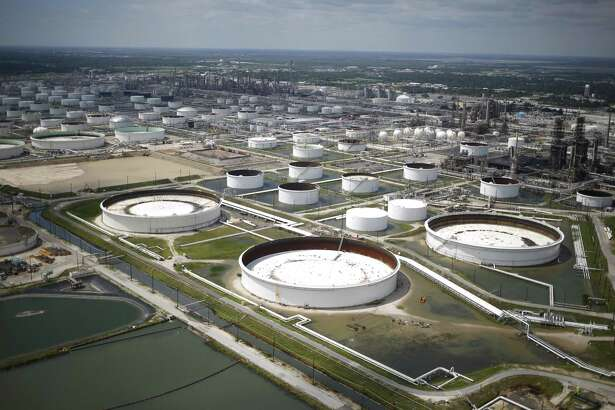 Rainwater from Hurricane Harvey surrounds oil refinery storage tanks in this aerial photograph taken above Texas City, Texas, U.S., on Wednesday, Aug. 30, 2017. Unprecedented flooding from the Category 4 storm that slammed into the state's coast last week, sending gasoline prices surging as oil refineries shut, may also set a record for rainfall in the contiguous U.S., the weather service said Tuesday. Photographer: Luke Sharrett/Bloomberg