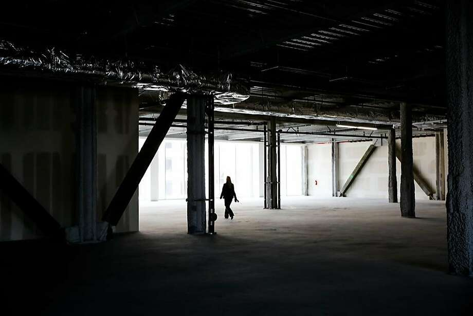 General manager Carie Yox gives a tour of the interior of 6x6, a new empty shopping center on Market Street between Fifth and Sixth Streets in San Francisco, Calif., on Wednesday, Aug. 30, 2017. Photo: Gabrielle Lurie, The Chronicle
