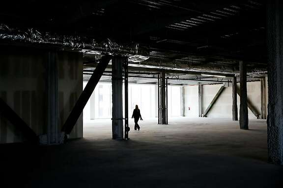 General manager Carie Yox gives a tour of the interior of 6x6, a new empty shopping center on Market Street between Fifth and Sixth Streets in San Francisco, Calif., on Wednesday, Aug. 30, 2017.