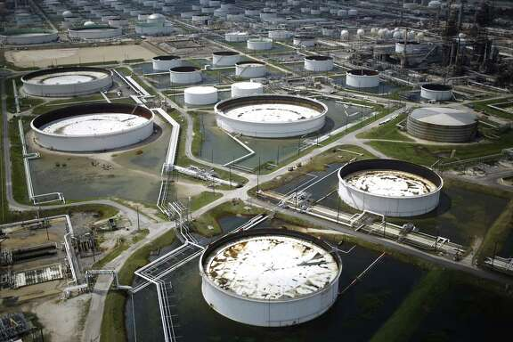 Rainwater from Hurricane Harvey surrounds oil refinery storage tanks stand in this aerial photograph taken above Texas City, Texas, U.S., on Wednesday, Aug. 30, 2017. Unprecedented flooding from the Category 4 storm that slammed into the state's coast last week, sendinggasoline pricessurging as oil refineries shut, may also set a record for rainfall in the contiguous U.S., the weather service said Tuesday. Photographer: Luke Sharrett/Bloomberg