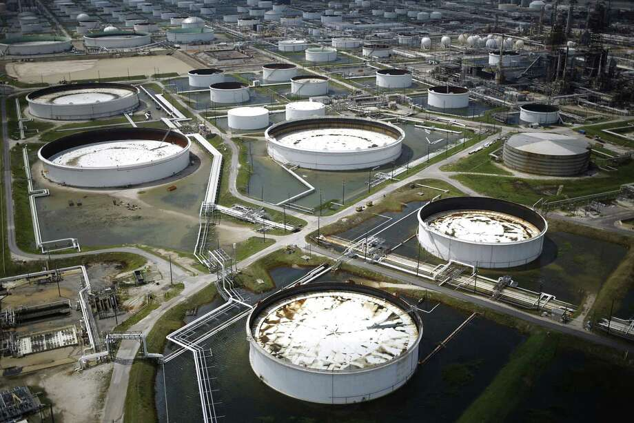 Rainwater from Hurricane Harvey surrounds oil refinery storage tanks stand in this aerial photograph taken above Texas City, Texas, U.S., on Wednesday, Aug. 30, 2017. Unprecedented flooding from the Category 4 storm that slammed into the state's coast last week, sending gasoline prices surging as oil refineries shut, may also set a record for rainfall in the contiguous U.S., the weather service said Tuesday. Photographer: Luke Sharrett/Bloomberg Photo: Bloomberg / © 2017 Bloomberg Finance LP