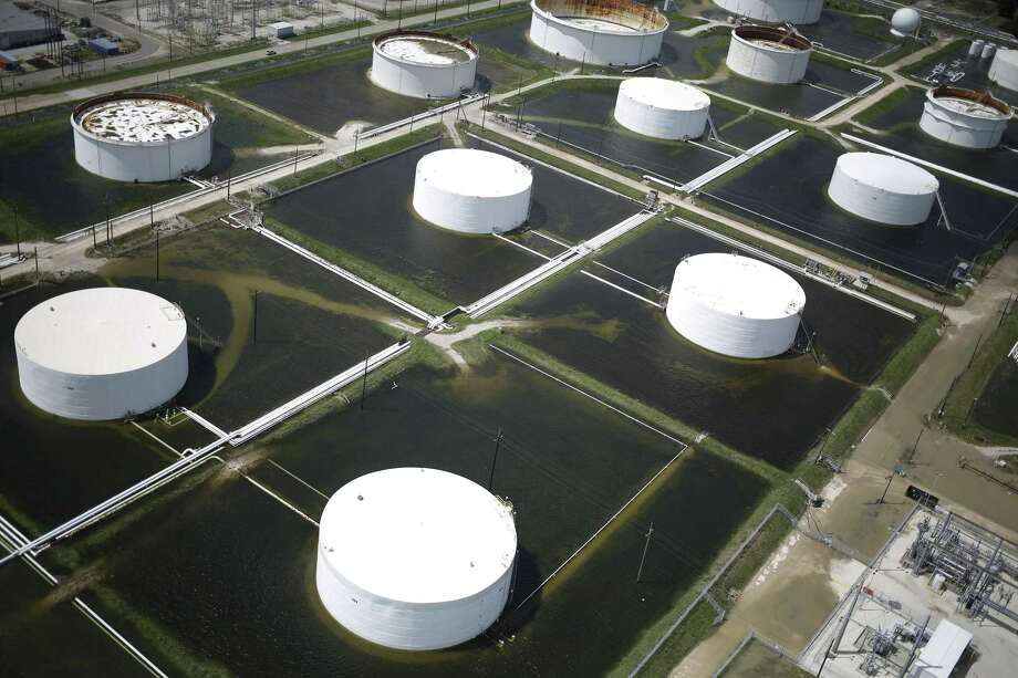 Rainwater from Hurricane Harvey surrounds oil refinery storage tanks in this aerial photograph taken above Texas City, Texas, U.S., on Wednesday, Aug. 30, 2017. Unprecedented flooding from the Category 4 storm that slammed into the state's coast last week, sendinggasoline pricessurging as oil refineries shut, may also set a record for rainfall in the contiguous U.S., the weather service said Tuesday. Photographer: Luke Sharrett/Bloomberg Photo: Bloomberg / © 2017 Bloomberg Finance LP