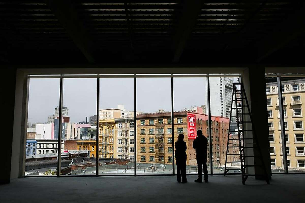 General manager Carie Yox (left) chats with Matt Dorsey (right) during a tour of the interior of 6x6, a new empty shopping center on Market Street between Fifth and Sixth Streets in San Francisco, Calif., on Wednesday, Aug. 30, 2017.